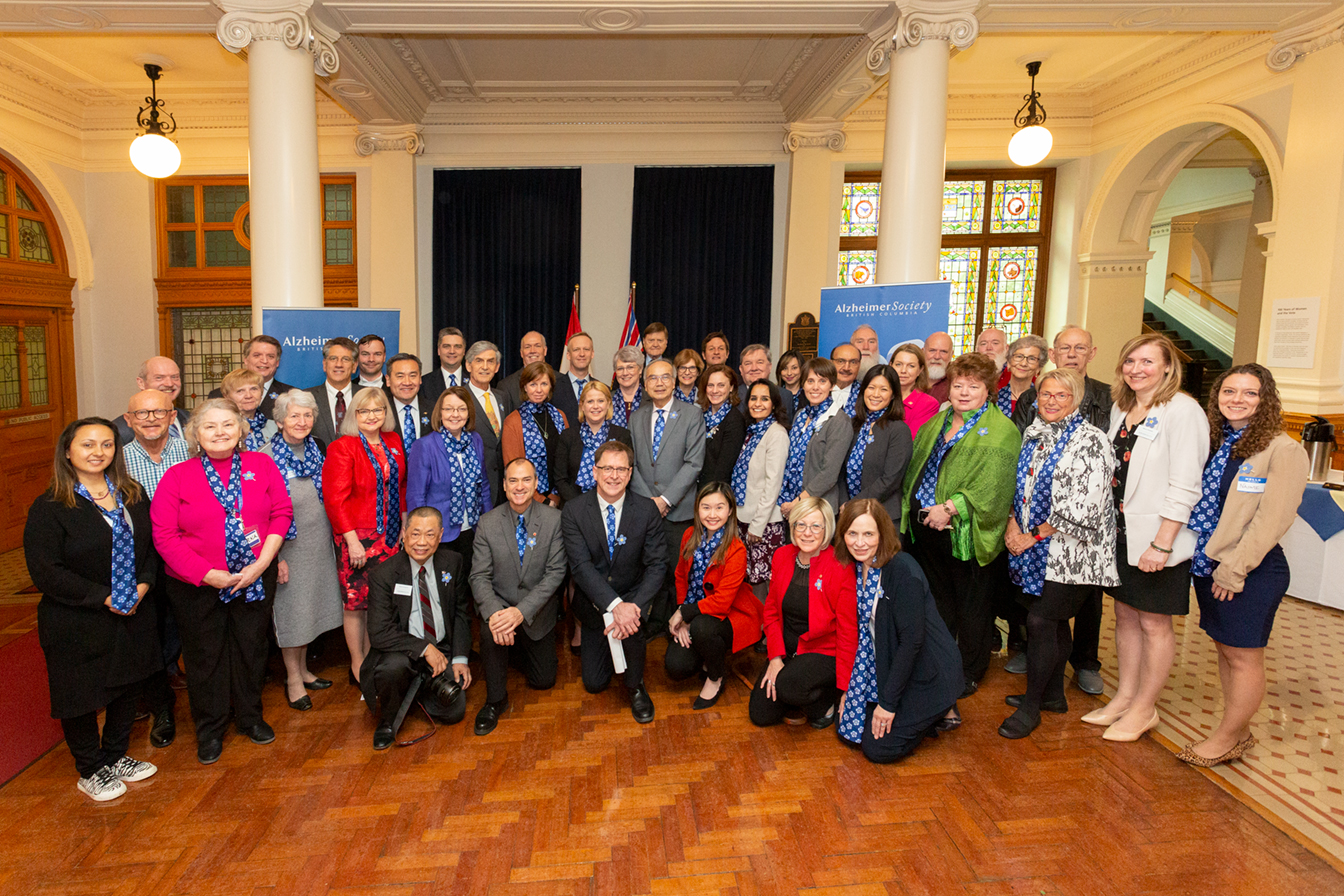 Society staff and volunteers pose for a group photo with members of B.C.'s Legislative Assembly.