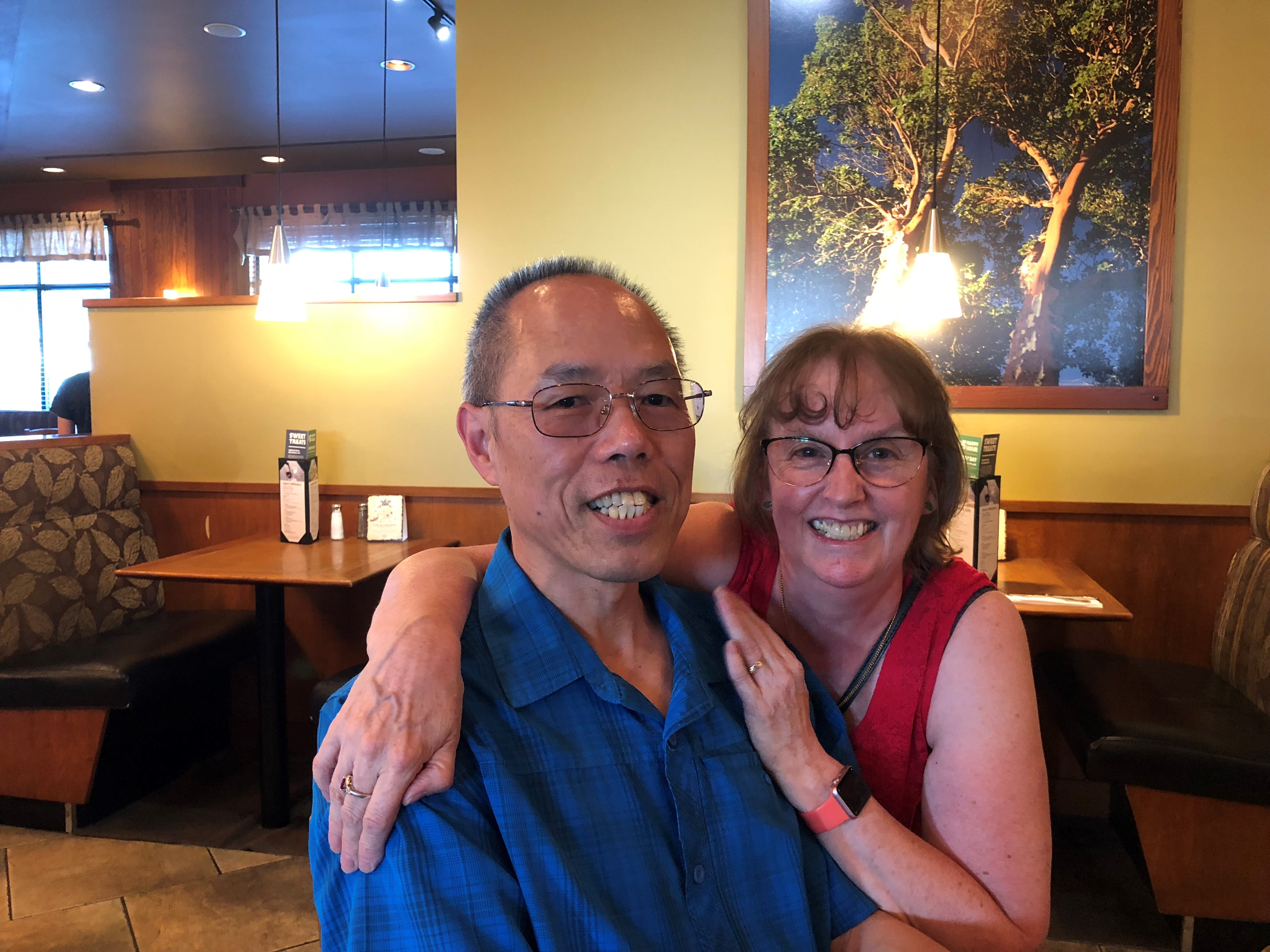 Kelvin and Linda Cheng sit together in a Coquitlam restaurant booth