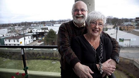 Ann and Fred West stand on the balcony of their Halifax condo, 2012. (INGRID BULMER /Chronicle Herald Staff)